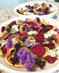 Homemade potpourri  I wanted to have some decorations for our bathroom and since there's no natural light for a plant I thought potpourri would be a great addition for something bright that also smells great. It was really fun and easy to make!  I got an assortment of flowers sliced up a lemon and orange and shaved peelings from a pomegranate. I put everything on parchment lined pans and put in the oven at 200 for 2 hours (the lemon and orange may take a bit longer so it helps to put them on…