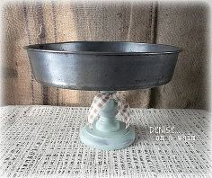 pedestal stand from a cake pan, home decor, repurposing upcycling, A cake pan and candlestick holder combine for a cute pedestal stand