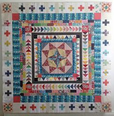 Marcelle Medallion quilt progress | Flickr - Photo Sharing! The use of the colors keeps bringing the eye back around the quilt. Lots of great ideas in this one.