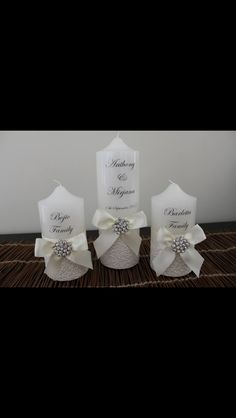 Wedding unity candles with ivory bubble decorative paper, large bow & gorgeous brooch.  It looks stunning!   Visit http://facebook.com/moderndesigns1 to see more products in my albums