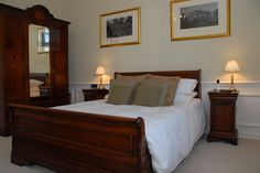King-sized sleigh beds in the luxury rooms at Goldsborough Hall