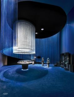 Visitors plunged into a mysterious alternate universe—saturated with sapphire blue and emerald green—at a jewelry exhibition by Interior Design Hall of Fame member P...