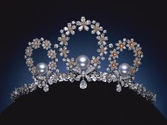 Mikimoto Pearl Tiara based on the theme: Tales of Flowers, which is inspired from the story of unique and exclusive seasonal flowers in Japan. The seasonal flower petals are meticulously crafted and set with diamonds, perfectly matching the central shining pearls.