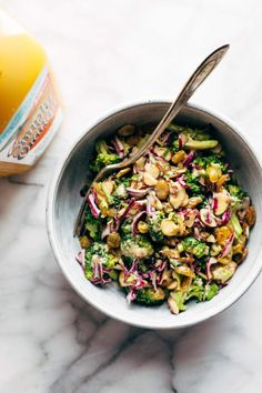 Super Clean Broccoli Salad with Creamy Almond Dressing - Pinch of Yum- CLEAN Broccoli Salad – non-mayo-based vegan goodness! with purple cabbage, raisins, almonds, green onions, and a creamy almond butter dressing. Whole Food Recipes, Vegetarian Recipes, Cooking Recipes, Healthy Recipes, Vegan Vegetarian, Brocolli Salad, Vegan Broccoli Salad, Clean Eating, Healthy Eating