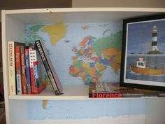 I like the idea of backing a bookcase with a large map.  I really want to do this for my son's room.  Think I would prefer an Old World style map, though.
