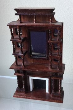 This is an Mahogany colored fireplace with shelves and a mirror that would be perfect for your miniature dollhouse or roombox. This is 1/2 scale and measures: 2 3/4 L x 1 W x 4 1/2 H Comes from mini estate and a smoke free environment. #miniestatesbykaren