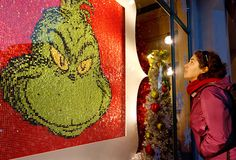 The Grinch may have stolen Christmas, but you couldn't steal visitors' eyes away from this shimmering holiday window display. Part of Universal Studios Hollywood's annual 'Grinchmas' celebration, the glittering window gave Dr. Seuss' classic character a decidedly sparkly new look.