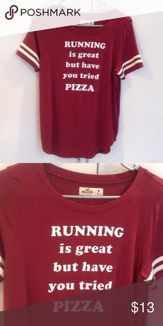 """Hollister tee new without tags My daughter pulled the tag off the realized it was not the right size!!! Brand new but tags are not attached (I have the. But they are not attached). """"Running is great but have you tried pizza"""" Hollister Tops Tees - Short Sleeve"""