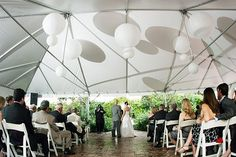 Doing the ceremony under the tent centered like this will give you more view of the woods/trees than if you corner it to the tent.