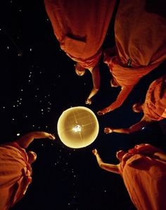Buddhist monks under a starry sky.