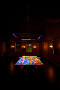 Artist Ryan McGinness' black light ping pong table was the centerpiece of a party with artist Shepard Fairey as special guest DJ.