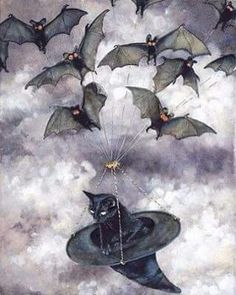 Bats flying a black cat in a witches hat!
