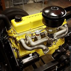 """""""This black and yellow Chevy 261 looks killer with that Fenton split header.  All cred to @castironphilosopher!"""""""
