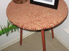Old cheap three legged table - recovered with fun textured fabric