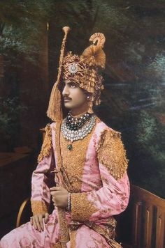 Rajasthan princes, 1920s. Possibly grooms since both wear sehras. The sherwani of pic 1 is probably silk with gold embroidery, pic 2 looks like a brocade jama.  The 'curtain sehra' is very Punjabi.  Flower/pearls etc ends that drop from each side of the head and also named d