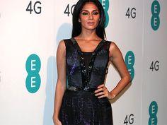 "Former Pussycat Dolls' singer Nicole Scherzinger lit up London in the U.K.'s first real-time ""Twitter dress."""