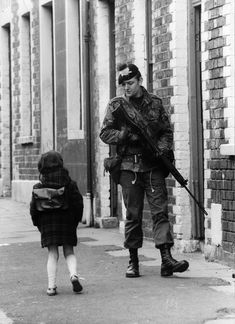 13th May 1981: A Belfast girl chats to a soldier out patrolling the streets in the Falls Road area. (Photo by Central Press/Getty Images)