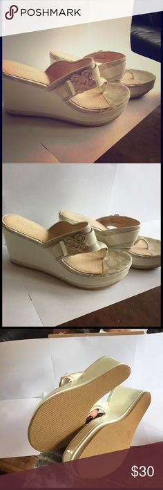 NWOT Coach wedge heels in White NWOT Coach wedge heels in White. These are NEW but please note there are a few scuffs or VERY slight discoloration from being boxed with other shoes. Scuffs are shown in the pictures above. Coach Shoes Wedges