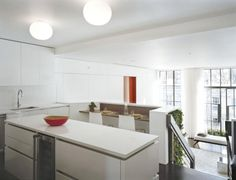 Cozy Dynamic House Design with the Modern Concept: White Kitchen Small Breakfast Nook Round Pendant Lamps Dynamic Duplex ~ anahitafurniture.com House Design Inspiration