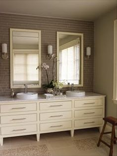 love how the vanity looks like a dresser, the tile is beautiful too...