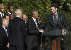 President Barack Obama congratulates Cleveland Cavaliers' forward Kevin Love during a ceremony on the South Lawn of the White House in Washington, Thursday, Nov. 10, 2016, where the president honored the 2016 NBA basketball champions.