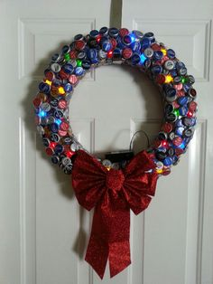 "Beer cap Christmas wreath. (trailer worthy)-14""diam. wreath base will take about 165 caps…change out bow for ""welcome"" sign and can leave up"