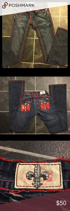 Laguna Beach Jeans-bootcut These jeans are a dark vintage wash with thick double stitching and features one of Laguna Beach's original leather pocket designs in a regular rise. This pair of denim is what true classic denim should look and feel like. These jeans have it all from style to comfort while keeping it simple, blue vintage wash - Front snap flat button - 97% cotton, 3% spandex - Heavy top stitching, Australian crystal label detail. Very minor wear along bottom hem. Distressed back…