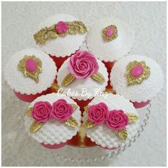 Hot pink , white & gold cupcakes  topped with roses & jewels Cakes.By.Kaz
