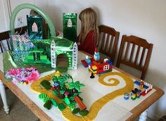 DIY Land of Oz- from making Emerald City, to using Legos to imprint playdough for the yellow brick road... and wait till you see all of the altered Polly Pockets and other little toys to make the characters!