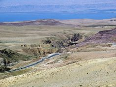 The road from the Dead Sea to Mount Nebo, Jordan, runs up this narrow gorge. Israeli-occupied Palestine is visible across the Dead Sea.