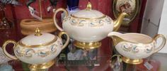 This adorable tea set contains a teapot, creamer, and sugar. They are gold rimmed and have blue and gold accents. They are marked Saddler England and are all three numbered 2640. This set can be yours for $129.00   You can find this item located in case number 337 owned by dealer number 750 (That's me!) at the Brass Armadillo Antique Mall in Phoenix.   Located at   12419 N 28th Dr, Phoenix, 85029.   Feel free to call ahead to make sure it's still available.   602-942-0030 or 888-942-0030