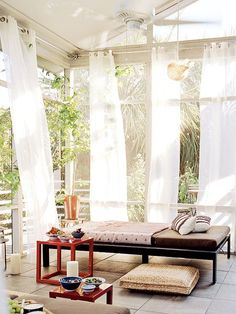 Backyard Paradise   An Outdoor Lounging Space Surrounded By Island Palms Is  Inherently Romantic; Fiery Bursts Of Red And Sheer Curtains Only Add To The  ...