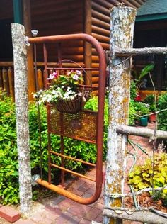 Old Metal Headboard of Bed...re-purposed into a rustic garden gate!