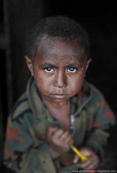 Boy in Akameku village, PAPUA NEW GUINEA