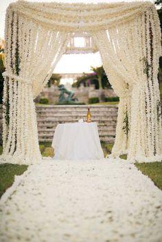 Such a pretty idea! White floral arbor.