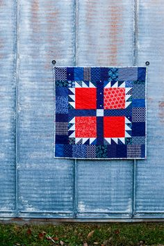 A quick and easy baby quilt tutorial featuring an oversized bear paw block. Instructions for using scraps or yardage.
