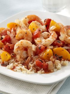Fresh shrimp cooked with fire roasted tomatoes, peaches and hot pepper sauce over rice – a simple, yet savory, spring dish!