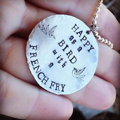 """Hand stamped disc tag necklace """"happy as a bird with a French fry"""" on Etsy, $23.00"""