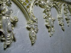 Rococo plaster relief. Angels in relief, wall frieze. Created by Ellie Ellis,CMS