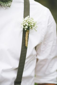 Twine-wrapped baby's breath boutonniere.