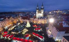 The largest Christmas market in the Czech Republic occupies Old Town Square, where visitors can stand beneath the city's tallest Christmas tree.