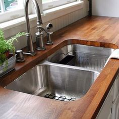 Absolutely love the idea of a cuttingboard countertop, but maybe just for an island.