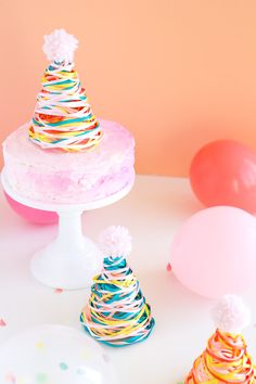 Colorful Ribbon Party Hats http://asubtlerevelry.com/colorful-ribbon-party-hats/