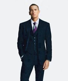 This is the first picture i have ever seen of Eminem in a suit. He looks so good but it is so weird