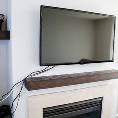 There is nothing that messes up a beautiful room like a mess of cords. Here is a simple way on how to hide tv cords in the wall. Click thru for tutorial! Tv Above Mantle, Tv Mount Over Fireplace, Above Fireplace Ideas, Mounted Fireplace, Hide Electrical Cords, Hide Cable Cords, Hide Cable Box, Hiding Wires Mounted Tv, Hide Tv Wires