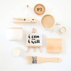 wood + white flatlay featuring my 'I can and I will' mini easel