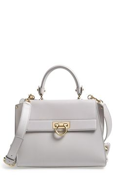 Salvatore Ferragamo 'Sofia' Satchel at Detailed with a gleaming Ferragamo flip lock and Gancini-cinched side gussets,