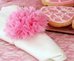 Learn how to make tissue paper pom poms with these easy step by step instructions!