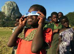 Girl looks at a total solar eclipse in Zimbabwe - Howard Burditt/Reuters