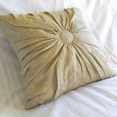 """Linen and cotton-blend throw pillow with gathered center.Product:  PillowConstruction Material: Linen and cotton cover Color: Fern        Features: Insert included   Dimensions: 18"""" x 18""""      Cleaning and Care: Machine washable"""